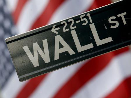 A street sign is seen in front of the New York Stock Exchange on Wall Street in New York, February 10, 2009. REUTERS/Eric Thayer