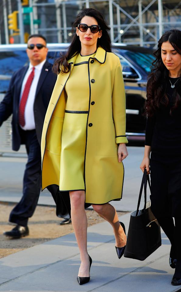 <p>Leave it to Clooney to brighten up a dreary winter day. While walking to the UN in New York on March 9, she dazzled in a matching dress and coat combination, finished off with chic pumps and her signature shades. <i>(Photo via Splash News)</i> </p>
