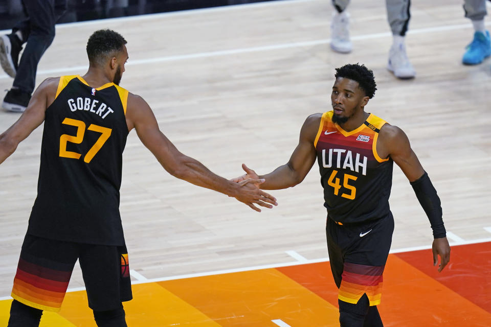 Utah Jazz's Rudy Gobert (27) congratulates Donovan Mitchell (45) after he scored against the Memphis Grizzlies during the first half of Game 5 of an NBA basketball first-round playoff series Wednesday, June 2, 2021, in Salt Lake City. (AP Photo/Rick Bowmer)
