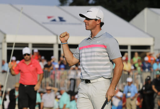 Rory McIlroy celebrates after winning the Bridgestone Invitational golf tournament Sunday, Aug. 3, 2014, at Firestone Country Club in Akron, Ohio. McIlroy's 15-under par total beat runner up Sergio Garcia by two shots. (AP Photo/Mark Duncan)