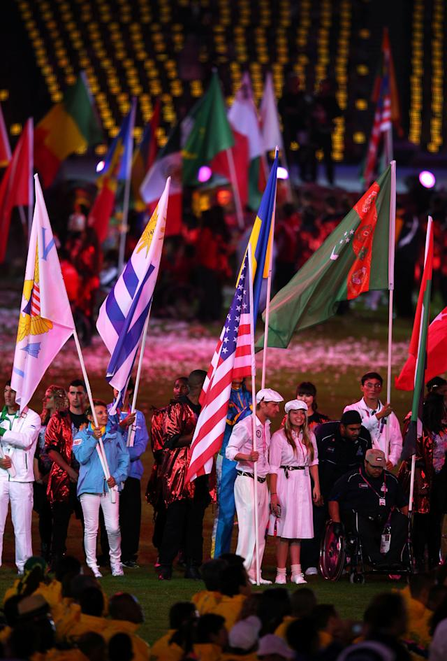 LONDON, ENGLAND - SEPTEMBER 09: Flag bearers carry their national flags during the closing ceremony on day 11 of the London 2012 Paralympic Games at Olympic Stadium on September 9, 2012 in London, England. (Photo by Hannah Johnston/Getty Images)