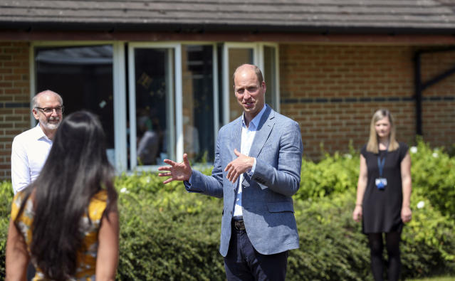The duke spoke to staff outside and followed social distancing rules. (PA Images)