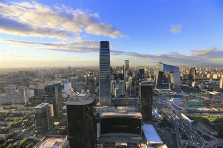 A view of the city's skyline from the Beijing Yintai Centre building at sunset is seen in Beijing