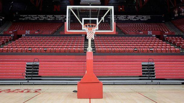 PHOTO: A basket post stands in front of folded bleachers at the Bob Devaney Sports Center, March 11, 2020, ahead of the Nebraska boys basketball tournament in Lincoln, Neb. (Nati Harnik/AP)