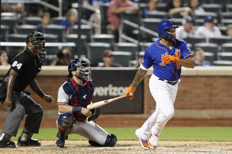 CORRECTS TO THREE-RUN HOME RUN NOT SOLO Home plate umpire Alan Porter and Atlanta Braves catcher Francisco Cervelli watch along with New York Mets' Dominic Smith as Smith's walk-off three-run home run sails over the outfield fence in a baseball game, Sunday, Sept. 29, 2019, in New York. (AP Photo/Kathy Willens)