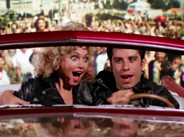 sandy and danny flying away from the carnival in a car