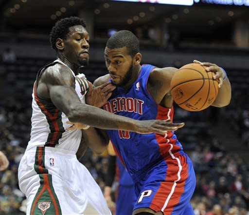 Milwaukee Bucks' Larry Sanders left, defends as Detroit Pistons' Greg Monroe drives to the basket during the first half of an NBA basketball game on Saturday, Oct. 13, 2012, in Milwaukee. (AP Photo/Jim Prisching)