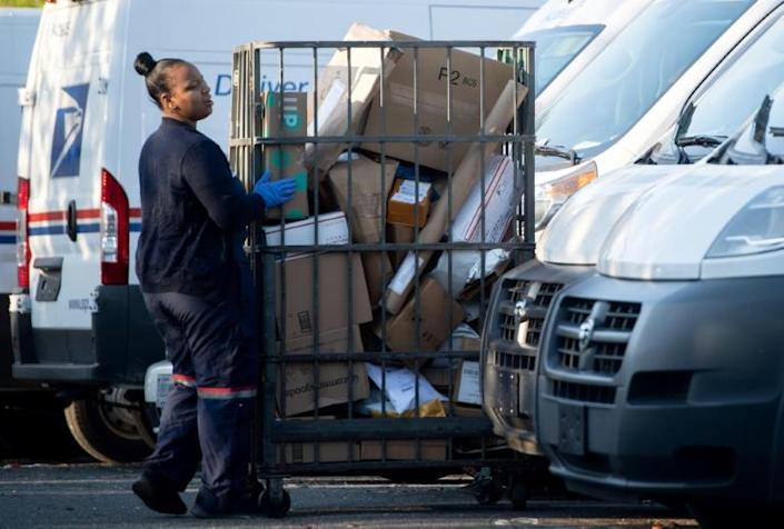 The US Postal Service has boosted package deliveries in recent years to make money, but it is still in deep financial trouble (AFP Photo/SAUL LOEB)