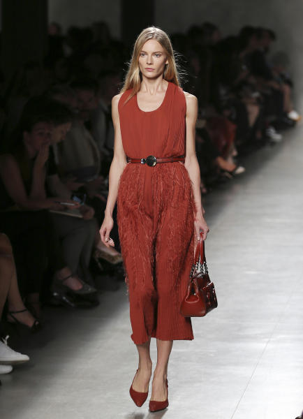 A model wears a creation for Bottega Veneta's women's Spring-Summer 2014 collection, part of the Milan Fashion Week, unveiled in Milan, Italy, Saturday, Sept. 21, 2013. (AP Photo/Antonio Calanni)