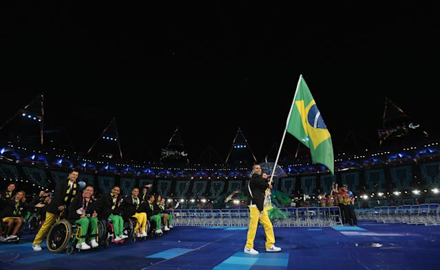 LONDON, ENGLAND - AUGUST 29: Swimmer Daniel Dias of Brazil carries the flag during the Opening Ceremony of the London 2012 Paralympics at the Olympic Stadium on August 29, 2012 in London, England. (Photo by Dan Kitwood/Getty Images)