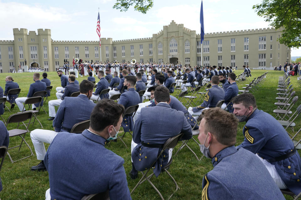 FILE - Virginia Military Institute class of 2021 watch during a change of command parade and ceremony on the parade grounds at the school in Lexington, Va., in this Friday, May 14, 2021, file photo. The findings of a months-long investigation into racism at the nearly two-century old Virginia Military Institute will be released Tuesday, June 12, 2021, according to the State Council of Higher Education for Virginia. (AP Photo/Steve Helber, File)