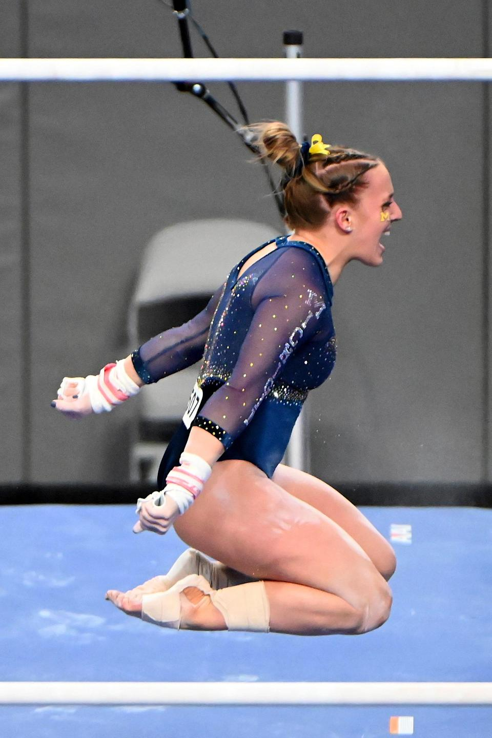 Michigan's Abby Heiskell celebrates after her performance on the uneven bars during the NCAA championships in Fort Worth, Texas, on Saturday, April 17, 2021.