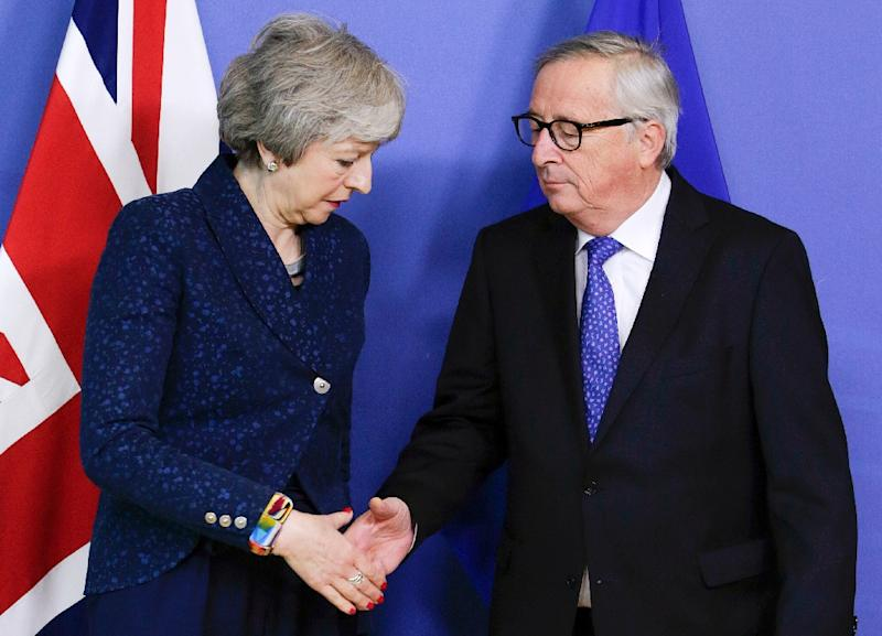 May (L), with European commission President Jean-Claude Juncker, twice delayed Britain's exit from the European Union (AFP Photo/Aris Oikonomou)