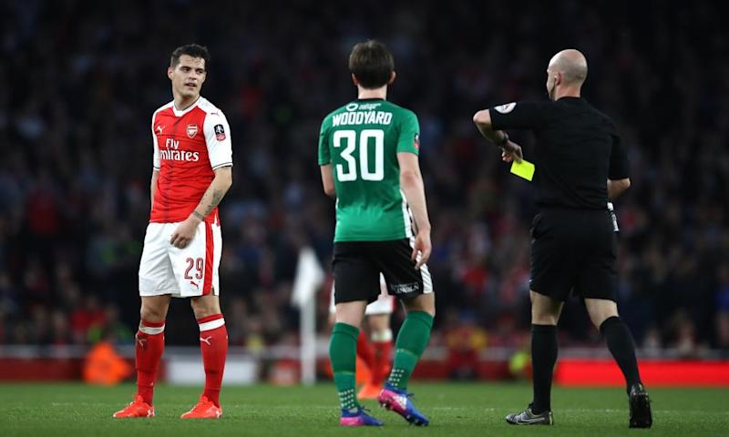 Granit Xhaka is booked for a crude tackle during Arsenal's FA Cup tie against Lincoln City; since the midfielder returned from suspension in February he has played in five matches and been booked in each.