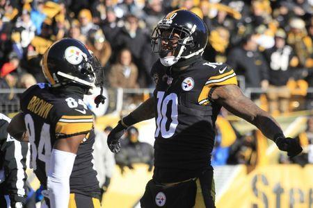 FILE PHOTO: Jan 14, 2018; Pittsburgh, PA, USA; Pittsburgh Steelers wide receiver Martavis Bryant (10) celebrates with Steelers wide receiver Antonio Brown (84) after scoring a touchdown against the Pittsburgh Steelers during the second quarter in the AFC Divisional Playoff game at Heinz Field. Mandatory Credit: Charles LeClaire-USA TODAY Sports