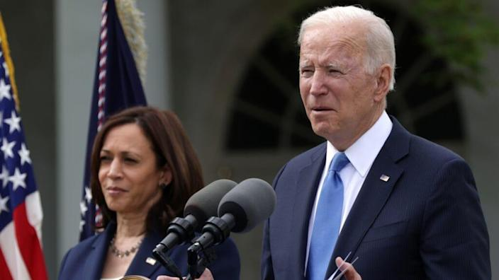 President Joe Biden delivers remarks in the Rose Garden of the White House on the COVID-19 response and vaccination program Thursday as Vice President Kamala Harris listens in. (Photo by Alex Wong/Getty Images)