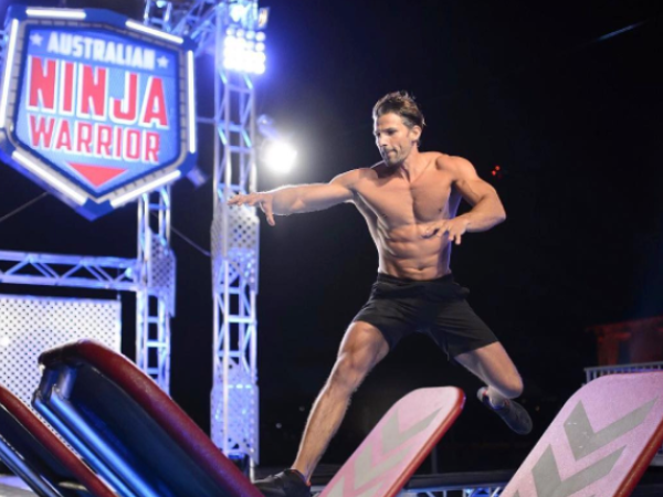 Tim Robards attempt at completing the assault course on Australian Ninja Warrior after teasing fans about his appearance for weeks. Source: Nine