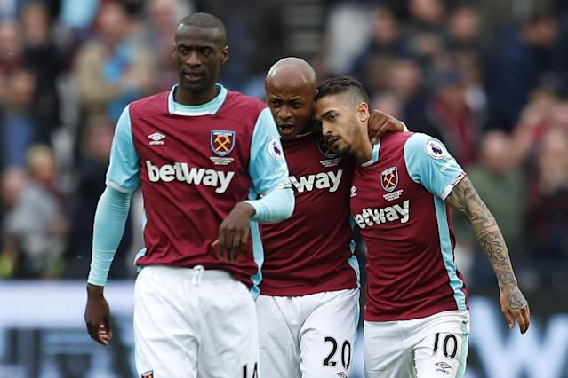 <p>West Ham United's Manuel Lanzini (R) celebrates scoring their first goal with Andre Ayew (C) </p>