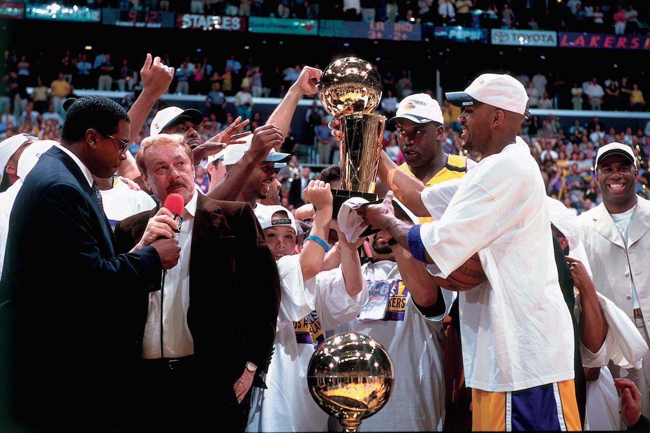 <p>@LOS ANGELES - JUNE 19: Los Angeles Lakers owner Jerry Buss is interviewed by sportscaster Ahmad Rashad while his team celebrates winning the NBA Championship after defeating the Indiana Pacers in Game Six of the 2000 NBA Finals on June 19, 2000 at the Staples Center in Los Angeles, California. NOTE TO USER: User expressly acknowledges that, by downloading and or using this photograph, User is consenting to the terms and conditions of the Getty Images License agreement. Mandatory Copyright Notice: Copyright 2000 NBAE (Photo by Andrew D. Bernstein/NBAE via Getty Images)</p>
