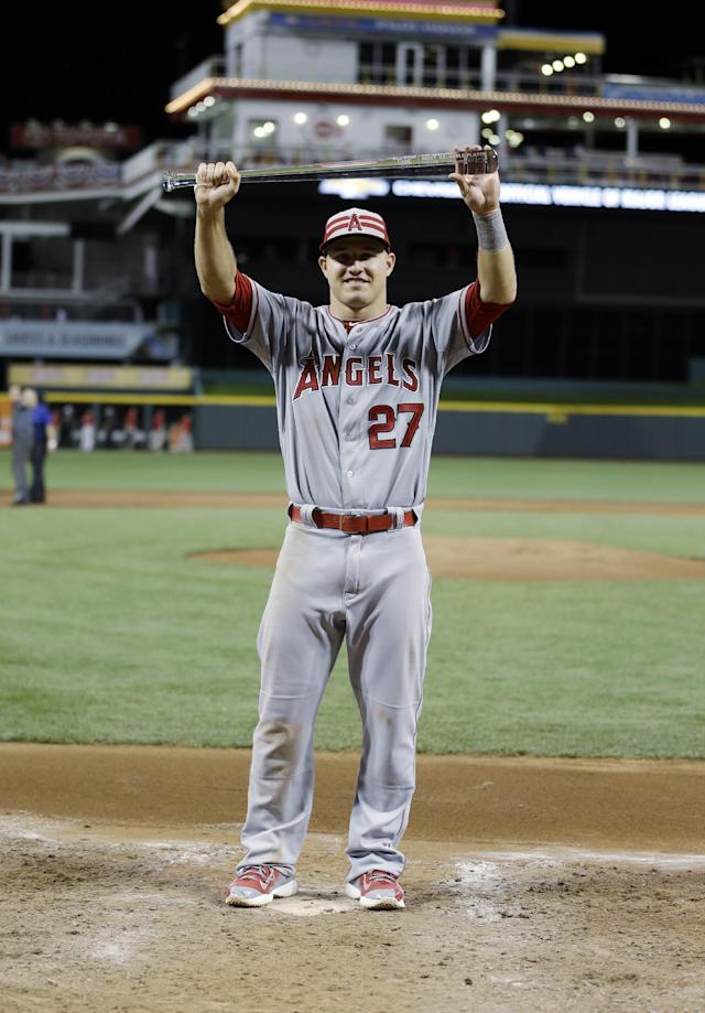American League's Mike Trout, of the Los Angeles Angels, holds the MVP trophy after the MLB All-Star baseball game, Tuesday, July 14, 2015, in Cincinnati. The American League won 6-3. (AP Photo/Jeff Roberson)