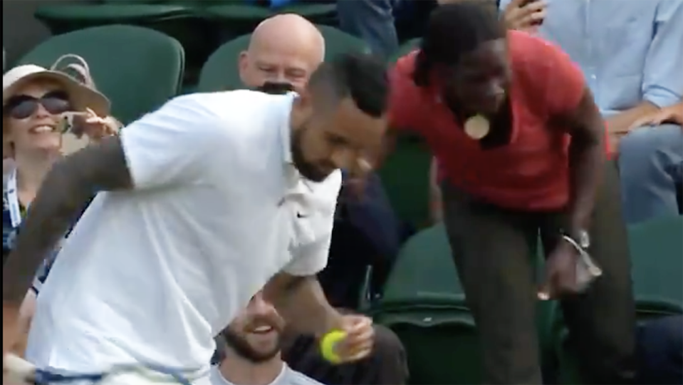 Nick Kyrgios asks a fan where to place his serve while on match point in Wimbledon's second round.
