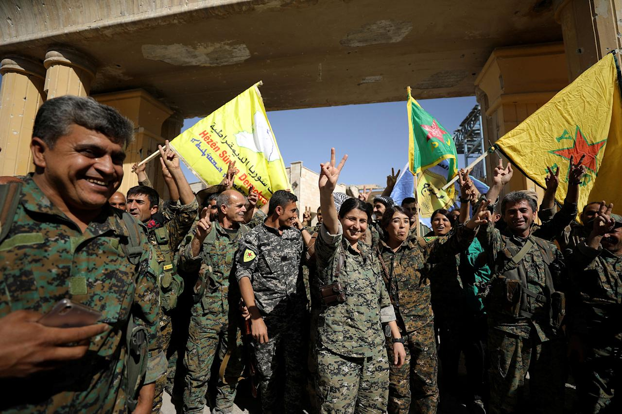 "<p>Fighters of Syrian Democratic Forces gesture the ""V"" sign in Raqqa, Syria, Oct. 17, 2017. (Photo: Rodi Said/Reuters) </p>"