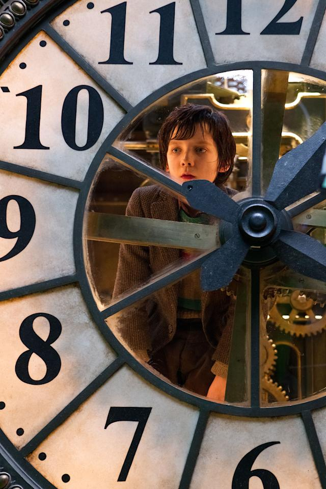 "In this image released by Paramount Pictures, Asa Butterfield portrays Hugo Cabret in a scene from ""Hugo."" The film, adapted from Brian Selznick's award-winning illustrated book ""The Invention of Hugo Cabret,"" is about a 12-year-old orphan who lives in a 1930 Paris train station. The film was nominated Thursday, Dec. 15, 2011 for a Golden Globe award for best motion picture drama. The Golden Globes will be presented Jan. 15 at the Beverly Hilton Hotel, televised live by NBC and hosted by Ricky Gervais. (AP Photo/Paramount Pictures, Jaap Buitendijk)"