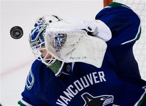 Vancouver Canucks' goalie Cory Schneider makes a save against the Edmonton Oilers during the third period of an NHL hockey game Thursday, April 4, 2013, in Vancouver, British Columbia. (AP Photo/The Canadian Press, Darryl Dyck)