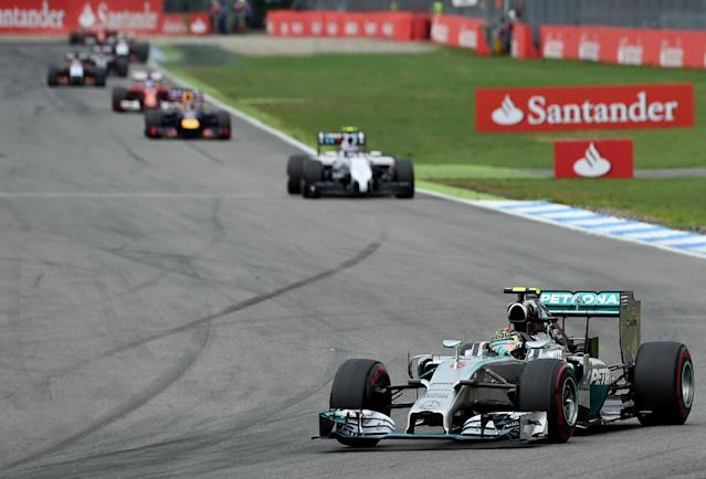 Mercedes driver Nico Rosberg (R), of Germany, leads after the start of the race at the German Grand Prix in Hockenheim on July 20, 2014 (AFP Photo/Patrick Stollarz)