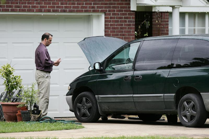 James Everett Dutschke works on his mini-van in his driveway in Tupelo Miss., Friday, April 26 2013. Dutschke, 41, was arrested after midnight Saturday at his home by FBI special agents in connection with the letters, FBI spokeswoman Deborah Madden said. The letters, which tests showed were tainted with ricin, were sent last week to Obama, Sen. Roger Wicker of Mississippi and earlier to an 80-year-old Mississippi judge, Sadie Holland. Madden said FBI special agents arrested Dutschke without incident. (AP Photo/Northeast Mississippi Daily Journal, Thomas Wells) MANDATORY CREDIT