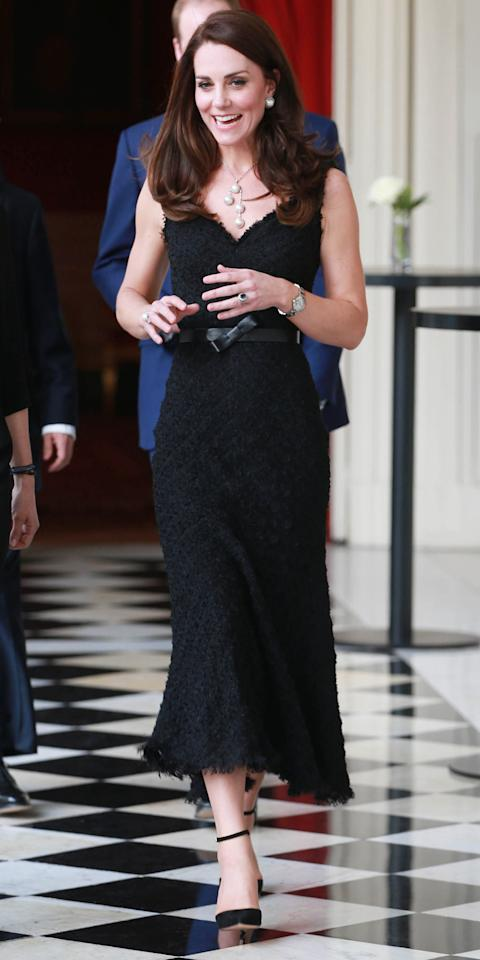 <p>Middleton stunned at a gala in Paris in a textured, mermaid-cut black Alexander McQueen gown, which she paired with a set of ankle strap pumps, a bow-adorned leather waist belt, a bold drop pearl necklace and a pair of complementary oversize pearl studs.</p>