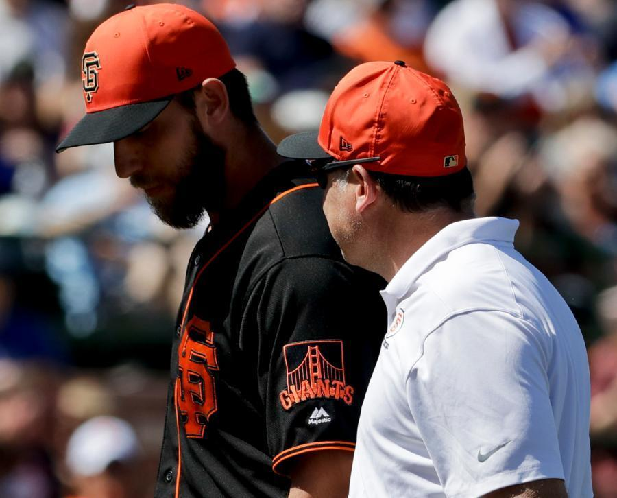 Giants left-hander Madison Bumgarner suffered a fractured left hand after being hit by comebacker in spring training game. (AP)
