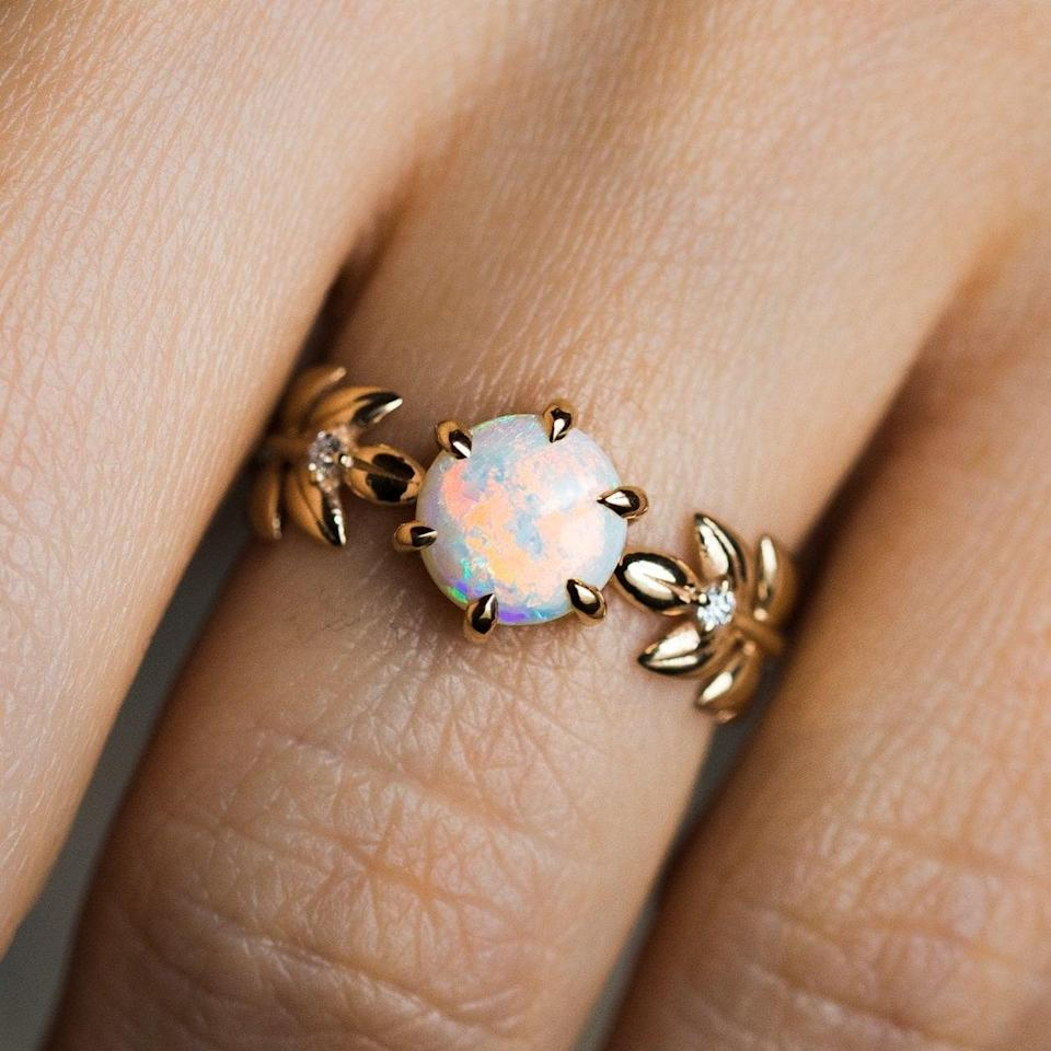 """<p>The leafy band on the <a href=""""https://www.popsugar.com/buy/Opal-Goddess-Ring-18K-532222?p_name=Opal%20Goddess%20Ring%20in%2018K&retailer=localeclectic.com&pid=532222&price=980&evar1=fab%3Aus&evar9=7954958&evar98=https%3A%2F%2Fwww.popsugar.com%2Fphoto-gallery%2F7954958%2Fimage%2F47021270%2FOpal-Goddess-Ring-in-18K&list1=shopping%2Cwedding%2Cjewelry%2Crings%2Cbride%2Cengagement%20rings%2Cfashion%20shopping&prop13=api&pdata=1"""" rel=""""nofollow noopener"""" class=""""link rapid-noclick-resp"""" target=""""_blank"""" data-ylk=""""slk:Opal Goddess Ring in 18K"""">Opal Goddess Ring in 18K</a> ($980) is not something you see every day. </p>"""
