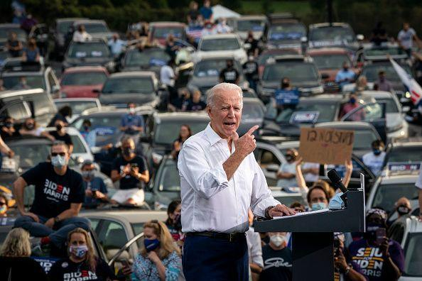 """<p>Two days later, Biden hosted a drive-in campaign rally in the parking lot of Cellairis Ampitheatre in Atlanta, Georgia. The """"drive-in"""" took place due to a surge of COVID-19 cases in the country. Meanwhile his opponent crowded supporters, many not wearing masks, into spaces at his rallies across the country, while continuing to downplay the pandemic. </p>"""