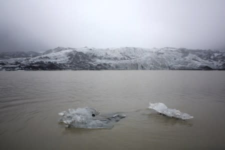 A view shows ice flow floating on a lake in front of the Solheimajokull Glacier, where the ice has receded by more than 1 kilometer since annual measurements began in 1931, Iceland