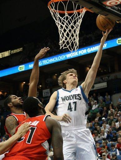 Portland Trail Blazers' LaMarcus Aldridge, left, and J.J. Hickson watch as Minnesota Timberwolves' Andrei Kirilenko, of Russia, lays up a shot in the first quarter of an NBA basketball game, Saturday, Jan. 5, 2013, in Minneapolis. (AP Photo/Jim Mone)