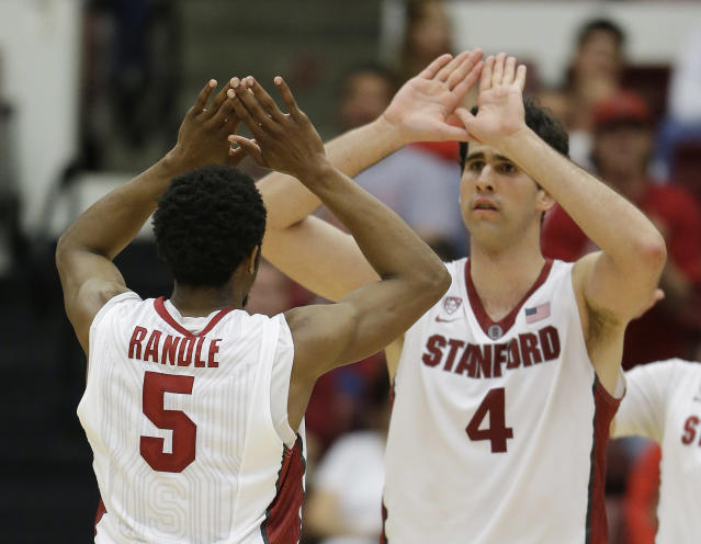 Stanford guard Chasson Randle, left, is greeted by teammate Stefan Nastic, right, after scoring in the second half of an NCAA college basketball game against Utah Saturday, March 8, 2014, in Stanford, Calif. Stanford won the game 61-60. (AP Photo/Eric Risberg)