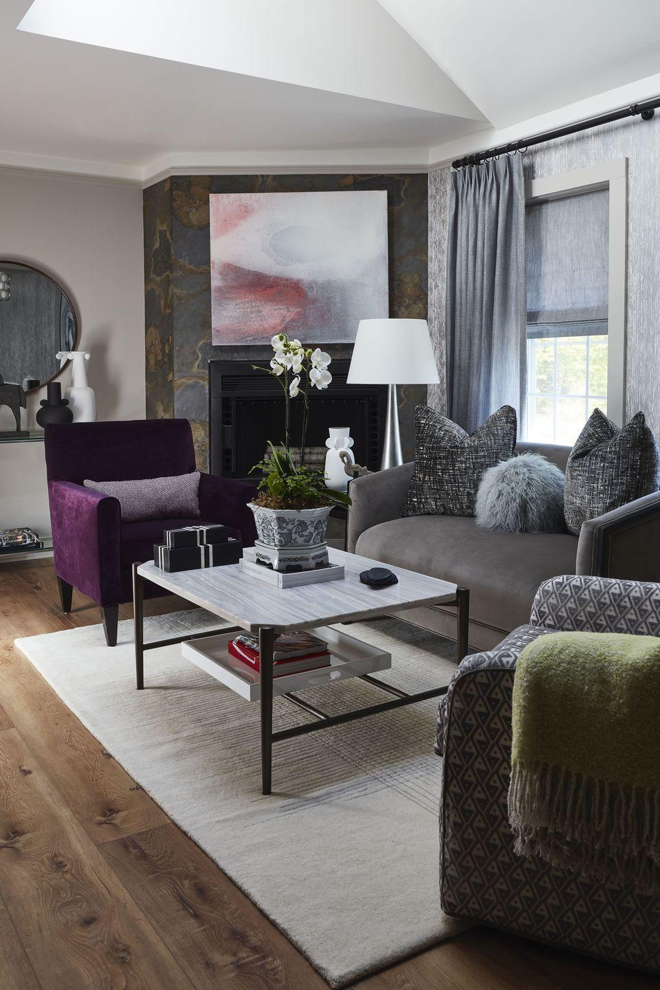 """<p>This room by Dennese Guadeloupe Rojas of <a href=""""http://www.interiorsbydesignmd.com/"""" rel=""""nofollow noopener"""" target=""""_blank"""" data-ylk=""""slk:Interiors by Design"""" class=""""link rapid-noclick-resp"""">Interiors by Design</a> is an homage to her mother. """"She took simple furnishings and accessories and created a luxurious yet inviting home where family and friends enjoyed gathering,"""" Rojas told us. Similarly, the designer arranged custom-upholstered seating in jewel tones around a cocktail table from <a href=""""https://www.universalfurniture.com/"""" rel=""""nofollow noopener"""" target=""""_blank"""" data-ylk=""""slk:Universal Furniture"""" class=""""link rapid-noclick-resp"""">Universal Furniture</a>. The fireplace's geode-like wallpaper is by <a href=""""https://vahallan.com/"""" rel=""""nofollow noopener"""" target=""""_blank"""" data-ylk=""""slk:Vahallan"""" class=""""link rapid-noclick-resp"""">Vahallan</a>, and the artwork is from <a href=""""https://iconicpineapple.com/"""" rel=""""nofollow noopener"""" target=""""_blank"""" data-ylk=""""slk:Iconic Pineapple"""" class=""""link rapid-noclick-resp"""">Iconic Pineapple</a>. """"My sincere hope is that many wonderful memories are created for all who visit the Doreen Suite at the Cornell Inn,"""" Rojas added.</p>"""