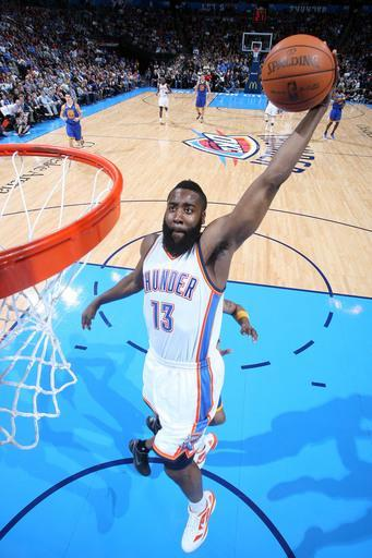 OKLAHOMA CITY, OK - FEBRUARY 17: James Harden #13 of the Oklahoma City Thunder goes to the basket during the game against the Golden State Warriors on February 17, 2012 at the Chesapeake Energy Arena in Oklahoma City, Oklahoma. (Photo by Layne Murdoch/NBAE via Getty Images)