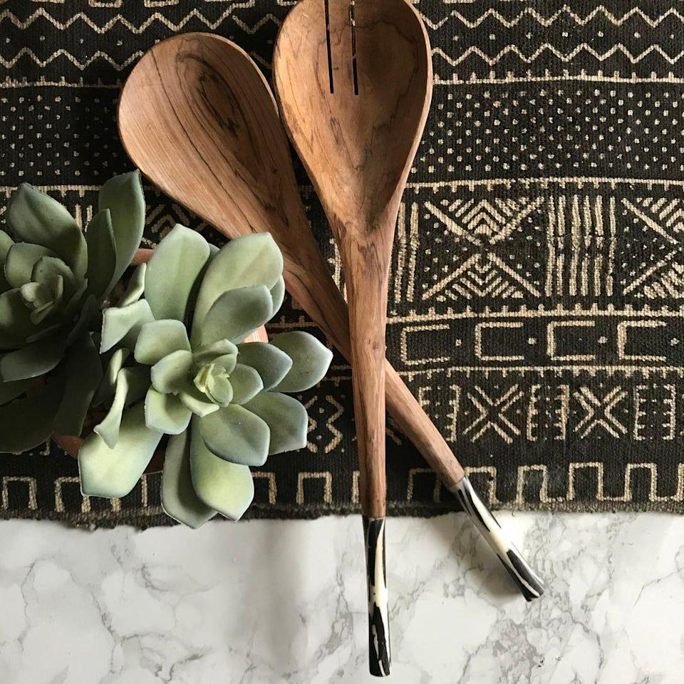 """<p><strong>Xn Studio</strong></p><p>xnasozistudio.com</p><p><strong>$50.00</strong></p><p><a href=""""https://www.xnasozistudio.com/product/salad-servers-olivewood-and-bone-inlay-black-design"""" rel=""""nofollow noopener"""" target=""""_blank"""" data-ylk=""""slk:BUY NOW"""" class=""""link rapid-noclick-resp"""">BUY NOW</a></p><p>Serve up some fun to friends who are always hosting dinner parties with these stylish salad spoons.</p>"""