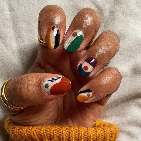 "<p>Sensing a theme here? Maximalist <a href=""https://www.cosmopolitan.com/style-beauty/beauty/g31401578/gel-nail-design-ideas/"" rel=""nofollow noopener"" target=""_blank"" data-ylk=""slk:nail designs"" class=""link rapid-noclick-resp"">nail designs</a>, like this geometric-print manicure, are going to be everywhere in 2021. Grab a few bold-colored polishes (think: <a href=""https://go.redirectingat.com?id=74968X1596630&url=https%3A%2F%2Fwww.ulta.com%2Finfinite-shine-long-wear-nail-polish-orangesyellowsgreens%3FproductId%3Dpimprod2010197&sref=https%3A%2F%2Fwww.cosmopolitan.com%2Fstyle-beauty%2Fbeauty%2Fg34702993%2F2021-nail-trends%2F"" rel=""nofollow noopener"" target=""_blank"" data-ylk=""slk:green"" class=""link rapid-noclick-resp"">green</a>, <a href=""https://www.mischobeauty.com/collections/nail-lacquer/products/good-kisser"" rel=""nofollow noopener"" target=""_blank"" data-ylk=""slk:red"" class=""link rapid-noclick-resp"">red</a>, and <a href=""https://www.amazon.com/Cirque-Colors-Cr%C3%A8me-Nail-Polish/dp/B076F8Y5JS/ref=sr_1_3?tag=syn-yahoo-20&ascsubtag=%5Bartid%7C10049.g.34702993%5Bsrc%7Cyahoo-us"" rel=""nofollow noopener"" target=""_blank"" data-ylk=""slk:mustard yellow"" class=""link rapid-noclick-resp"">mustard yellow</a>) and use them to doodle a few different shapes on each nail. Seal it all in with a glossy <a href=""https://go.redirectingat.com?id=74968X1596630&url=https%3A%2F%2Fwww.ulta.com%2Fdry-fast-top-coat%3FproductId%3Dprod6051231&sref=https%3A%2F%2Fwww.cosmopolitan.com%2Fstyle-beauty%2Fbeauty%2Fg34702993%2F2021-nail-trends%2F"" rel=""nofollow noopener"" target=""_blank"" data-ylk=""slk:top coat"" class=""link rapid-noclick-resp"">top coat</a> and you're good to go.</p><p><a href=""https://www.instagram.com/p/CHtH3o6jdJz/?utm_source=ig_embed&utm_campaign=loading"" rel=""nofollow noopener"" target=""_blank"" data-ylk=""slk:See the original post on Instagram"" class=""link rapid-noclick-resp"">See the original post on Instagram</a></p>"