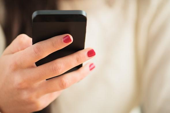 Close-up Of Woman's Hand Using Cell Phone