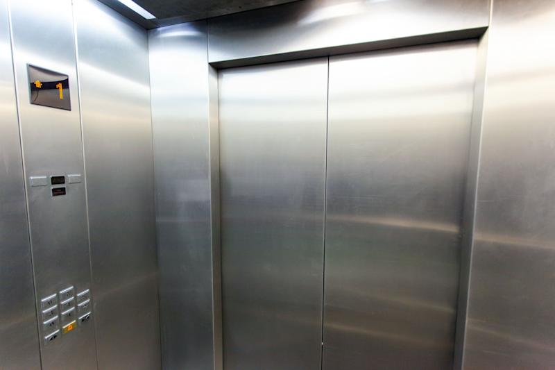 "One of the recommendations from the Centers for Disease Control and Prevention is to ""limit use and occupancy of elevators to maintain social distancing."" (Photo: Sergey Granev via Getty Images)"