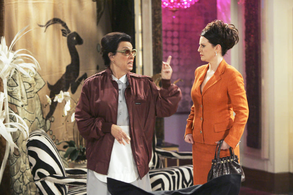 Megan Mullally as Karen Walker and Shelley Morrison as Rosario Salazar wearing the infamous Members Only jacket in 'Will & Grace' (Photo: NBC/Getty Images)