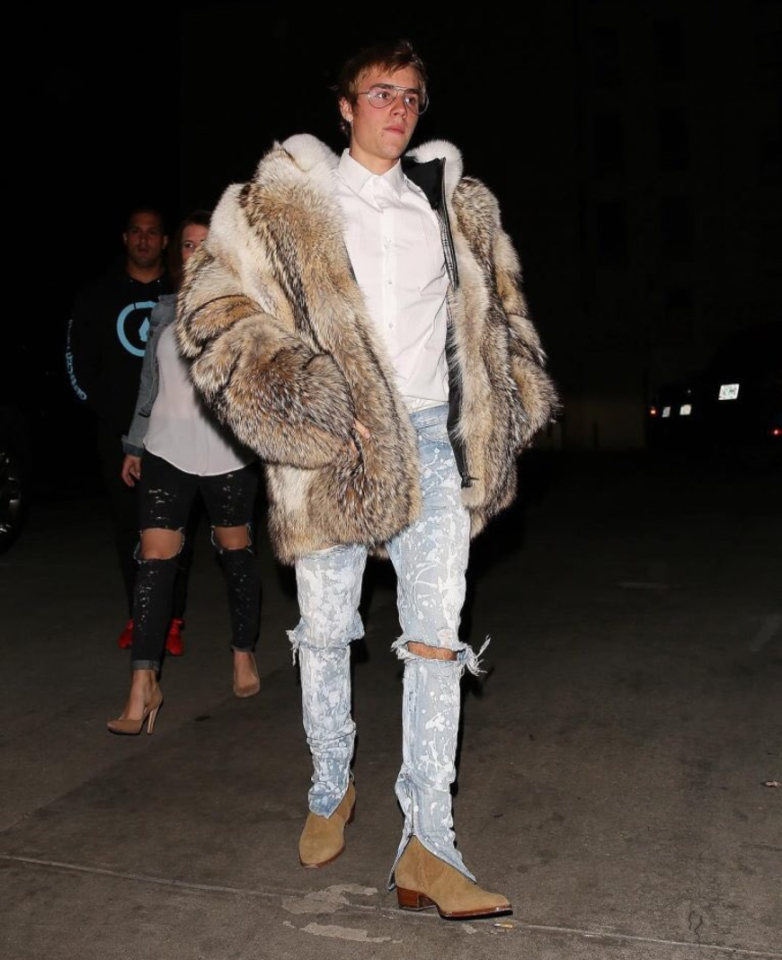 """<p>Justin was spotted leaving a club this week wearing a monster fur coat by Burberry. He was labelled a """"childish showoff"""" by animal rights group PETA. <i>[Photo: Twitter/UpscaleHype]</i> </p>"""