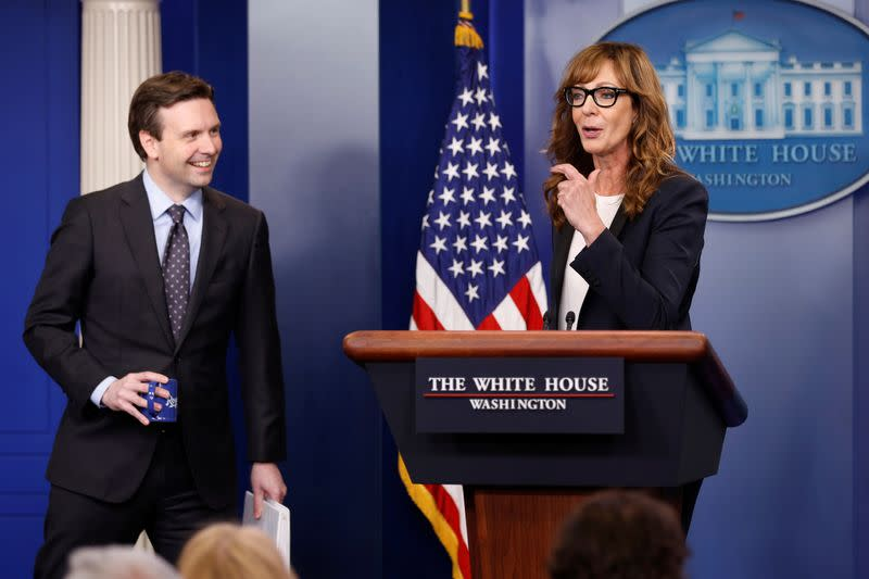 FILE PHOTO: Earnest and actress Janney stand together at the lectern before the daily press briefing at the White House in Washington
