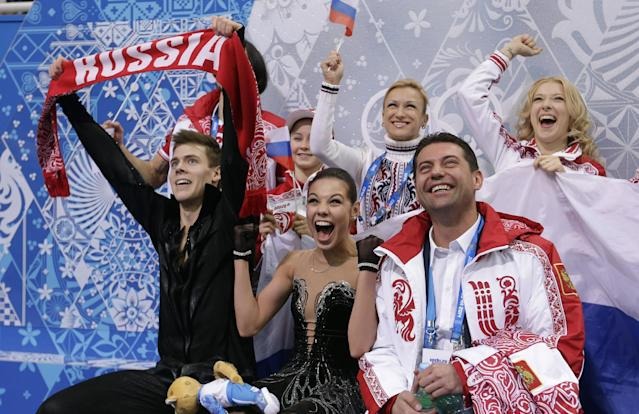 Elena Ilinykh and Nikita Katsalapov of Russia, left, react as they sit in the results area after competing in the team free ice dance figure skating competition at the Iceberg Skating Palace during the 2014 Winter Olympics, Sunday, Feb. 9, 2014, in Sochi, Russia. (AP Photo/Darron Cummings, Pool)
