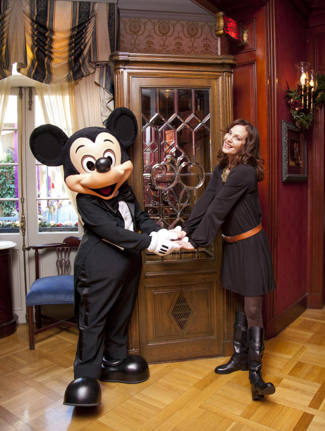 Oscar-nominated actress Lesley Ann Warren poses with Mickey Mouse inside Club 33 at Disneyland park on December 29, 201. (Paul Hiffmeyer/Disney Parks via Getty Images)