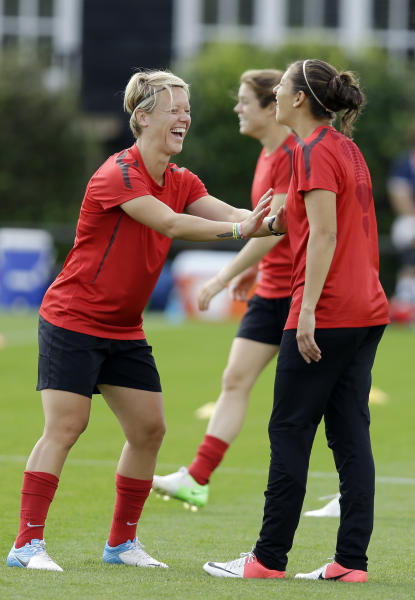 Lori Lindsey, of the United States women's soccer team, left, jokes with an unidentified teammate in London, Wednesday, Aug. 8, 2012, ahead of the upcoming women's soccer final at the 2012 Summer Olympics. (AP Photo/Lefteris Pitarakis)
