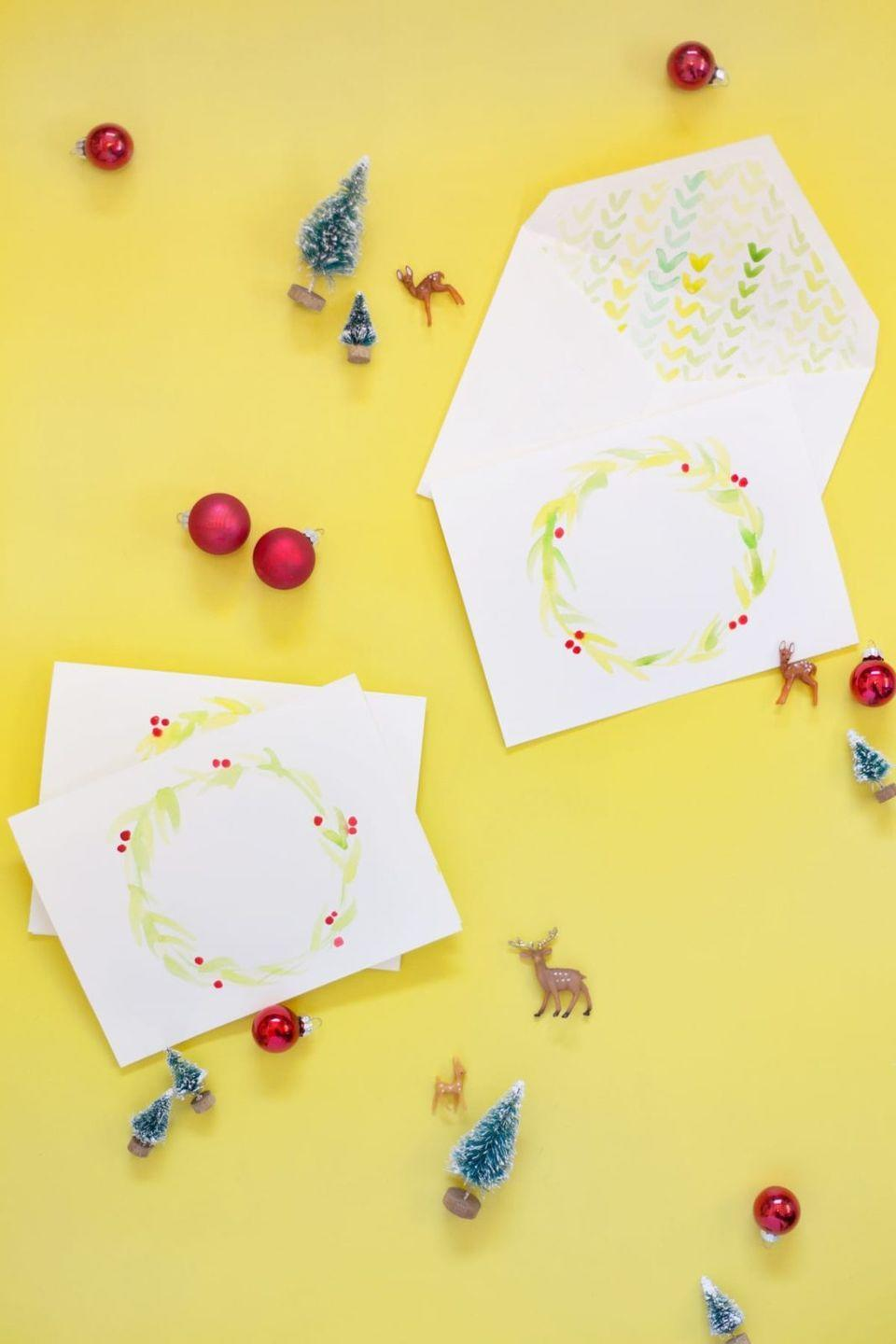 """<p>This design proves you don't have to get too intricate with watercolors to create an impressive Christmas card. (Though you will get bonus points for crafting matching envelope liners.) </p><p><em>Get the tutorial at <a href=""""https://lovelyindeed.com/diy-watercolor-holiday-cards-envelope-liners/"""" rel=""""nofollow noopener"""" target=""""_blank"""" data-ylk=""""slk:Lovely Indeed"""" class=""""link rapid-noclick-resp"""">Lovely Indeed</a>.</em></p><p><a class=""""link rapid-noclick-resp"""" href=""""https://www.amazon.com/Watercolor-Paint-Joyful-Colors-Lightweight/dp/B07QLLJP3B/?tag=syn-yahoo-20&ascsubtag=%5Bartid%7C10072.g.34351112%5Bsrc%7Cyahoo-us"""" rel=""""nofollow noopener"""" target=""""_blank"""" data-ylk=""""slk:SHOP WATERCOLORS"""">SHOP WATERCOLORS</a></p>"""